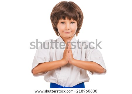 Karate kid. Little boy in karate pose. Karate choreography position. - stock photo