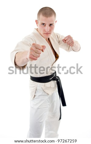 Karate. Man in a kimono on the white background