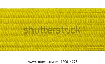 Karate yellow belt closeup isolated on white background - stock photo
