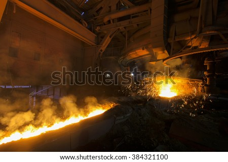 KARDEMIR, TURKEY -DECEMBER 04, 2011: Work on the ceiling of the battery when charging coke oven with coal, Turkey on December 2011. Kardemir Karabuk Iron and Steel Industry and Trade on December 2011
