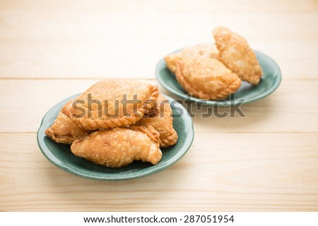Karee puff, Curry puff stuffed with vegetable - stock photo