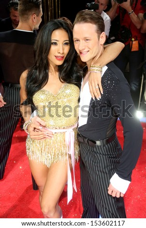 Karen Hauer and Kevin Clifton arriving for Strictly Come Dancing red carpet launch event held at Elstree studios, London. 03/09/2013
