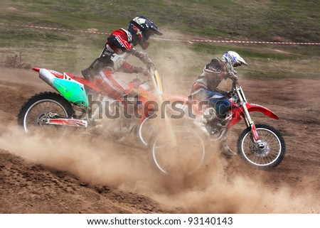 """KARGALY, KAZAKHSTAN - APRIL 10: A.Laskin(17) in action at Motocross competition """"Fabrichny Cup""""- Open Championship of Kazakhstan, on April 10, 2011 in Kargaly, Kazakhstan. - stock photo"""