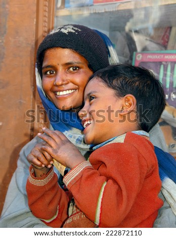 KARGIL/INDIA - JUNE 22: Unidentified tribe woman poses for photo on June 22, 2014 in Kargil, Ladakh range, Jammu & Kashmir, India. She comes with her son from poor nepalese village in search of work  - stock photo