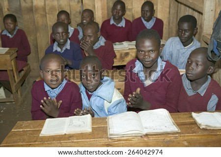 Karimba School with school children at their desk in classroom in North Kenya, Africa - stock photo