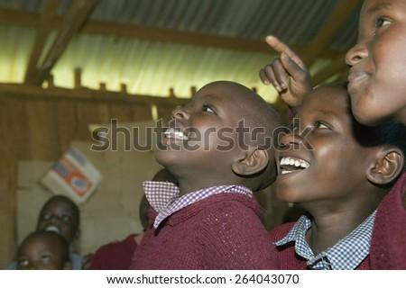 Karimba School with school children smiling in classroom in North Kenya, Africa - stock photo