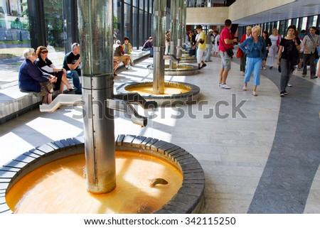 KARLOVY VARY, CZECH REPUBLIC - AUG 16, 2013: Hot spring colonnade in spa town Karlovy Vary, West Bohemia, Czech republic. Famous historical springs, most visited in CR. - stock photo