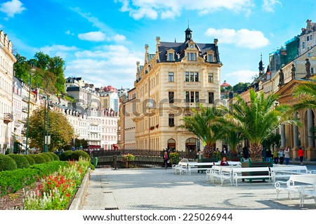 KARLOVY VARY, CZECH REPUBLIC - SEPTEMBER 20, 2012: People walking along Hot springs colonnade in Karlovy Vary. Karlovy Vary historically famous for its hot springs (13 main springs, about 300 smaller) - stock photo