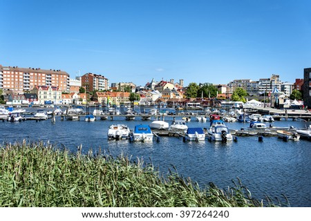 Karlskrona, Sweden - July 07, 2014: Central marina with boats, pier and buildings