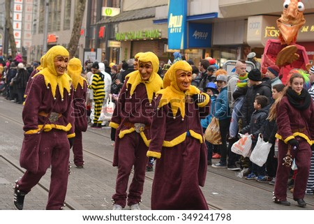 Karlsruhe, Baden Wuerttemberg, Germany - February 16, 2015: The 300th anniversary of the city of Karlsruhe, annual Carnival and parade, Fasching. The traditional withces scaring kids. - stock photo