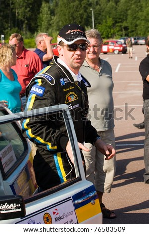 KARLSTAD, SWEDEN - JULY 16: Vladimir Antonov getting out of his rally car during  Midnattsolsrallyt in Karlstad, Sweden on July 16, 2010.