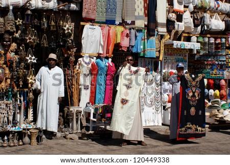 KARNAK EGYPT NOVEMBER 26:Men sale souvenirs in typical street market on november 26 2009 Karnak Egypt. More than 20 percent of Egypts 76 million people live below the poverty line. - stock photo