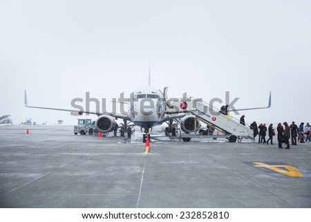 KARS - TURKEY , JANUARY 30: Sunexpress Airlines aircraft parked in the Kars Airport, on January 30 2014 in Kars Turkey.   - stock photo