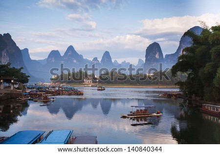 karst mountain landscape and reflection in yangshuo, guilin, - stock photo