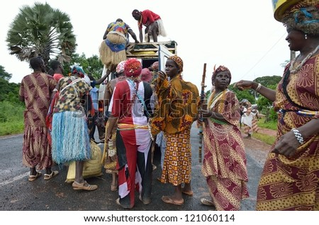 KARTIAK,SENEGAL-SEPT 18:people on the road go to a ritual of Boukoutt of Initiation ceremony on Sept 18,2012 in Kartiak, Senegal.The ceremony occurs every 30 years and celebrates boys becoming men.