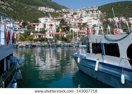 KAS, TURKEY - APRIL 15: Harbor of the fishing village Kas in Turkey on April 26, 2013. Kas is a small tourist town on the Mediterranean Coast, part of Antalya Province. - stock photo