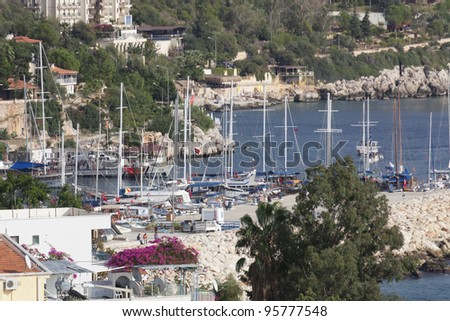 KAS, TURKEY - OCTOBER 15: Harbor of the fishing village Kas in Turkey on October 15, 2009. Kas is a small fishing, diving, yachting and tourist town and part of Antalya Province. - stock photo