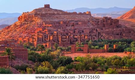Kasbah Ait Benhaddou, Morocco, glowing in the evening sun - stock photo