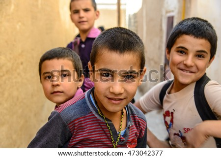 KASHAN, IRAN - OCTOBER 11, 2014: several children posing for a picture