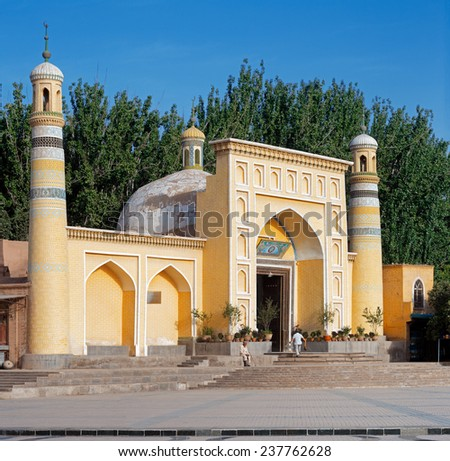 KASHGAR, CHINA - JUL 11: Id Kah Mosque, Kashgar, Xinjiang privince on Jul 11, 2014 in Kashgar, China. This is the largest Mosque in China, a central place of worship for the local Uyghur population - stock photo