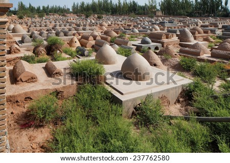 KASHGAR, CHINA - JUL 11: Old Uyghur tombs in Kashgar, Xinjiang, Province, Western China on Jul 11, 2014 in Kashgar, China. Uyghur population are a Turkic ethnic group living in Asia - stock photo