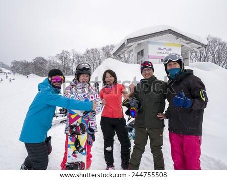 KASHIMAYARI, NAGANO, JAPAN - January 5. , 2015: Winter view mountain valley snow field, Kashimayari, Nagano, Japan.Unidentified Snowboarders enjoy their holiday. - stock photo