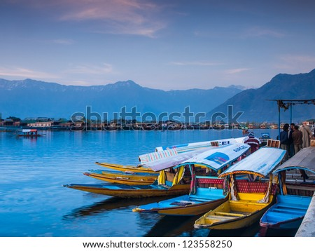 """KASHMIR, INDIA-APRIL 10: Dal lake, the tourist attractive destination in northern India. People use 'Shikara"""" for traveling and transportation in the lake on April 10, 2009 in Kashmir, India - stock photo"""