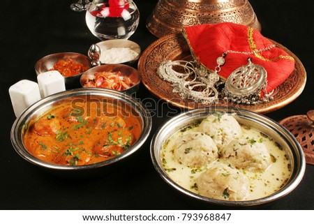 Kashmiri Dum Aloo is  baby potatoes is a vibrant curd based gravy and Goshtaba is a popular Kashmiri non-veg dish.