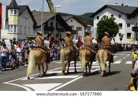 "KASTELRUTH, ITALY - JUNE 15: Unidentified people by yearly event named ""Oswald von Wolkenstein Ritt""- a traditional horseback riding tournament in South Tyrol, on June 15, 2013 in Casteltrotto, Italy"