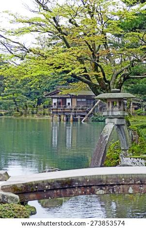 Kasumigaike Pond and Kotoji Toro Lantern inside Kenrokuen Garden  - stock photo