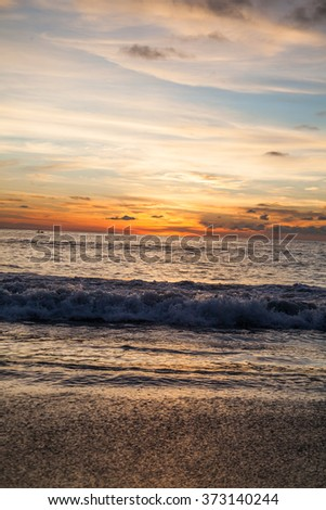 Kata Beach shoreline, Thailand at sunset with clouds - stock photo