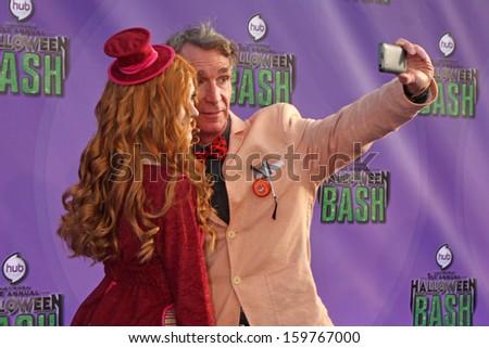 Katherine McNamara and Bill Nye at the Hub Network First Annual Halloween Bash. Barker Hangar, Santa Monica, CA 10-20-13 - stock photo