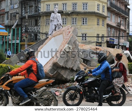 KATHMANDU - APRIL 27: Nepalese people look at the statue after earthquake, end of April 2015, Kathmandu, Nepal - stock photo