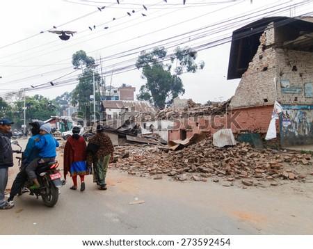 KATHMANDU, NEPAL - APRIL 26, 2015: Damaged building after the 7.8 earthquake hit Nepal on 25 April 2015. - stock photo