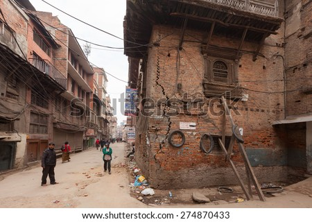 KATHMANDU, NEPAL - APRIL 25, 2015: Damaged living house in Kathmandu city after big earthquake