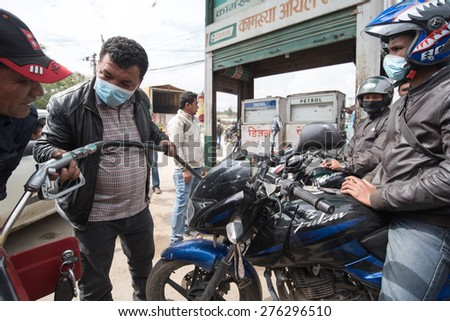 KATHMANDU, NEPAL APRIL 30, 2015: Long queue of Motorcycles at the petrol pump as there is shortage of petrol and diesel - stock photo
