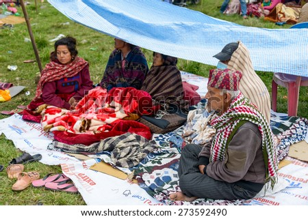 KATHMANDU, NEPAL - APRIL 26, 2015: People stay on an open ground at Chuchepati after their first night outside after the 7.8 earthquake on 25 April 2015. - stock photo