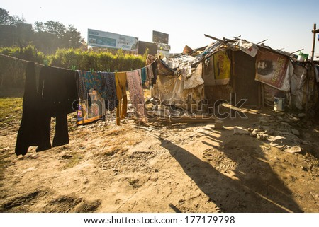 KATHMANDU, NEPAL - DEC 16, 2013: Illegal houses at slums in Tripureshwor district, Kathmandu. Caste of untouchables in Nepal, is about 7 % of population.