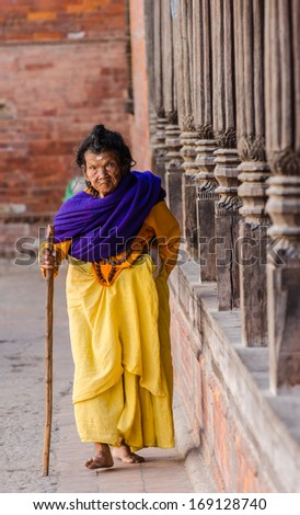 KATHMANDU, NEPAL - DECEMBER 04: An elderly woman walks in the Social welfare center Briddhashram (Elderly's home) on December 04, 2013 in Kathmandu, Nepal - stock photo