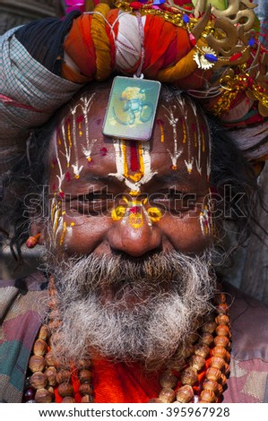 KATHMANDU, NEPAL - FEB 02: Unidentified  Holy Sadhu men with traditional painted face, blessing in Pashupatinath Temple. on February 02, 2014, Kathmandu, Nepal.