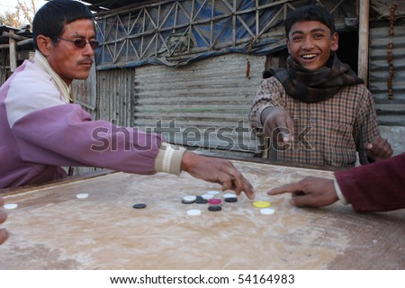 KATHMANDU, NEPAL - JANUARY 7: An unidentified people play chips of a poor area at Old Baneshwor near Bagmati river, January 7, 2009 in Kathmandu Nepal.