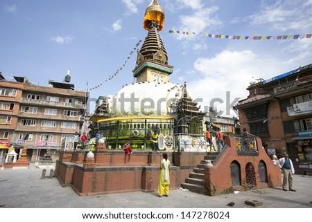 KATHMANDU, NEPAL - JULY 23 : An Unidentified Pilgrimageand tourists around Boudnath,Tibetan Buddhists follow around biggest Stupa in the Kathmandu, Nepal on April 23, 2013 in Kathmandu, Nepal - stock photo