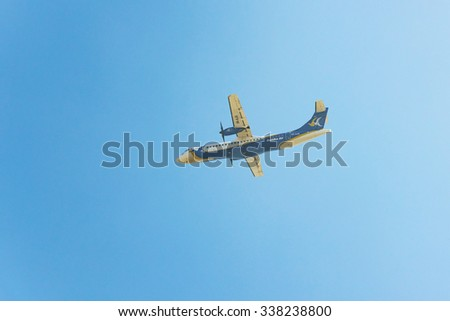 KATHMANDU, NEPAL - MARCH 2, 2014: A Buddha Air ATR 72-500 after taking off from Tribhuvan International Airport.