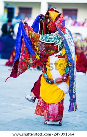 KATHMANDU, NEPAL - MARCH 25: Buddhist monk performing Mahakala dance during Cham Mystery at Shechen monastery on March 25, 2010 in Kathmandu, Nepal - stock photo