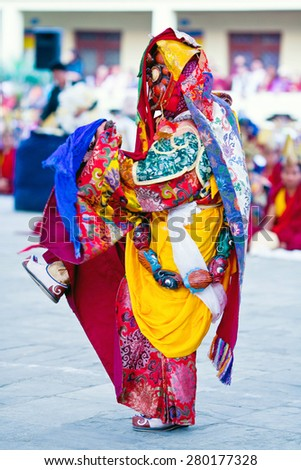 KATHMANDU, NEPAL - MARCH 25: Buddhist monk performing Mahakala dance during Cham Mystery at Shechen monastery on March 25, 2010 in Kathmandu, Nepal.  - stock photo