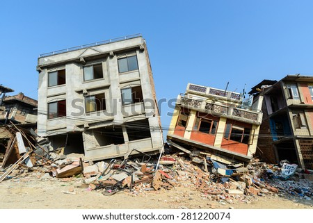 KATHMANDU, NEPAL - MAY 22, 2015: Two partially collapsed buildings after two major earthquakes hit Nepal on April 25 and May 12, 2015. - stock photo