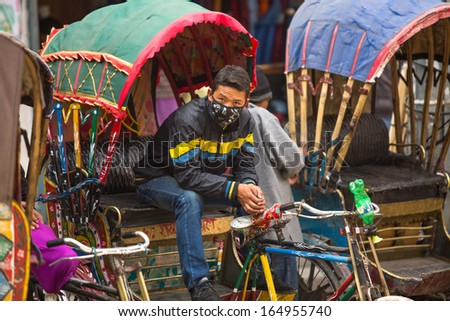 KATHMANDU, NEPAL - NOV 28: Unidentified nepali rickshaw in historic center of city, Nov 28, 2013 in Kathmandu, Nepal. Largest city of Nepal, its historic center, a population of over 1 million people.