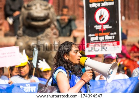KATHMANDU, NEPAL - NOV 29: Unidentified participants protest within a campaign to end violence against women (VAW), Nov 29, 2013 in Kathmandu, Nepal. Held annually since 1991, 16 days Nov 25 - Dec 10.