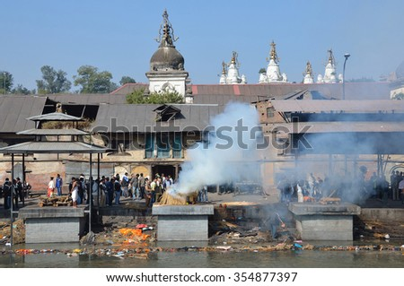 Kathmandu, Nepal, November, 13, 2012, Pashupatinath complex, cremation of dead on the banks of the sacred Bagmati river.  In spring 2015 complex  was partially destroyed during the earthquake