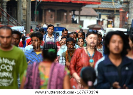 KATHMANDU, NEPAL- SEPTEMBBER 28: Crowd of local Nepalese people on the streets during the Dashain festival in Kathmandu on Sept 28, 2013 in Kathmandu, Nepal - stock photo